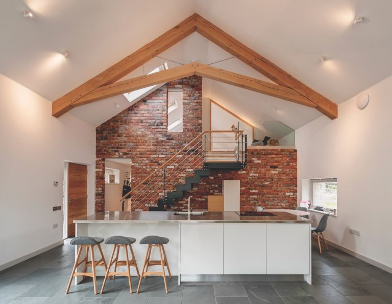 Extension Cost Calculator Inside Of A Timber Frame With White Scheme And High Ceilings