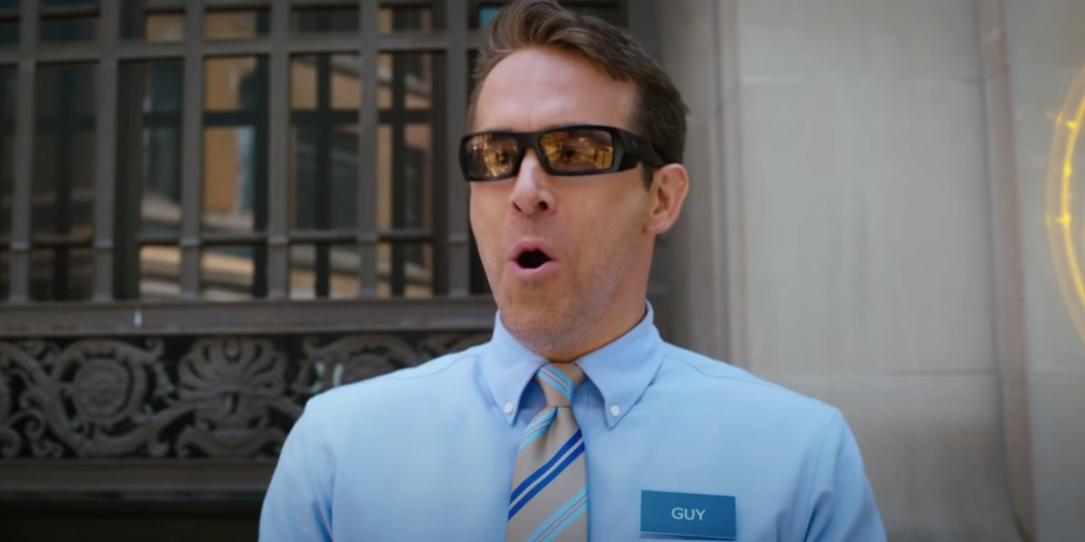Free Guy Ryan Reynolds smiling while wearing glasses