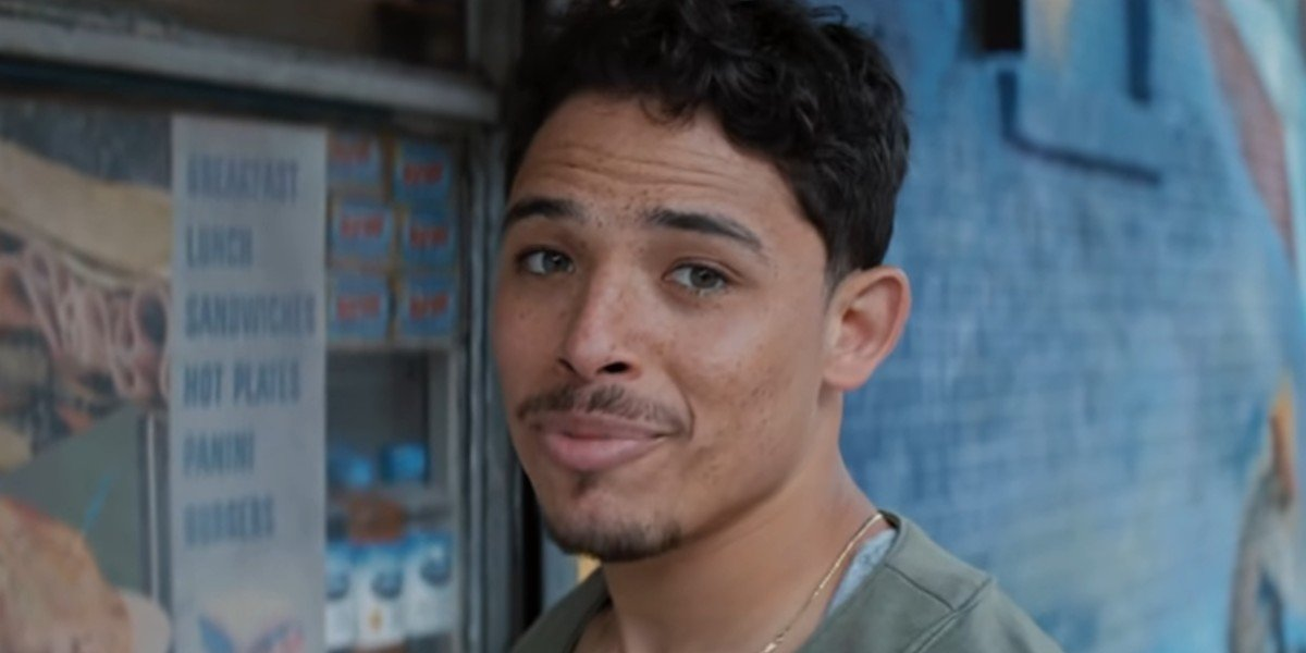Usnavi opening up his bodega during In the Heights trailer