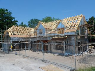 a timber frame home under construction