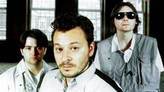 Manic Street Preachers standing in a deserted room