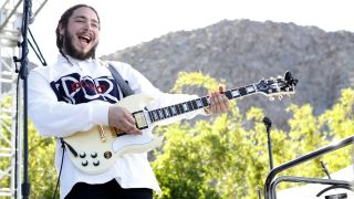 Post Malone performs on stage at the Coachella Republic Records Jaegermeister Party at Republic House on April 17, 2016 in Palm Springs, California