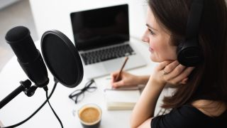 Woman records a podcast