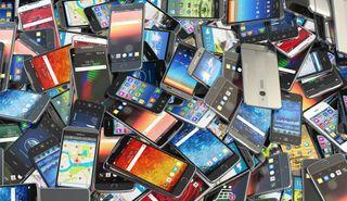 Pile of older smartphones.