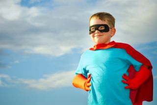 Boy dressed as a superhero.