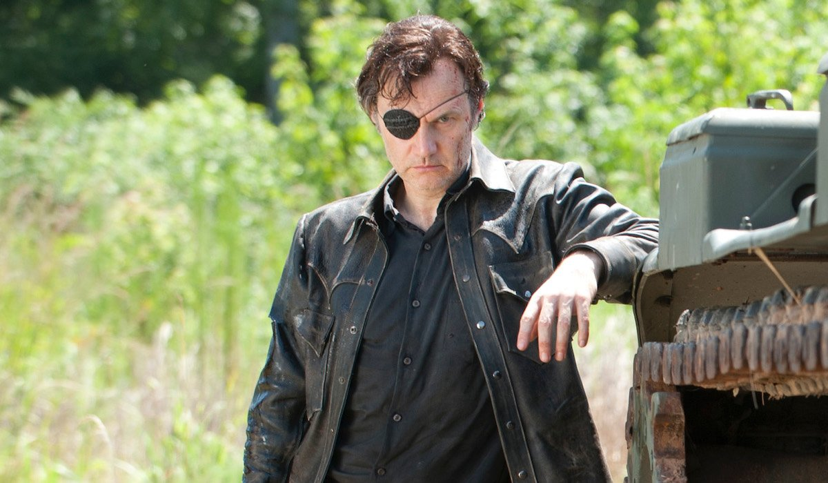 the walking dead's governor hanging on a tank