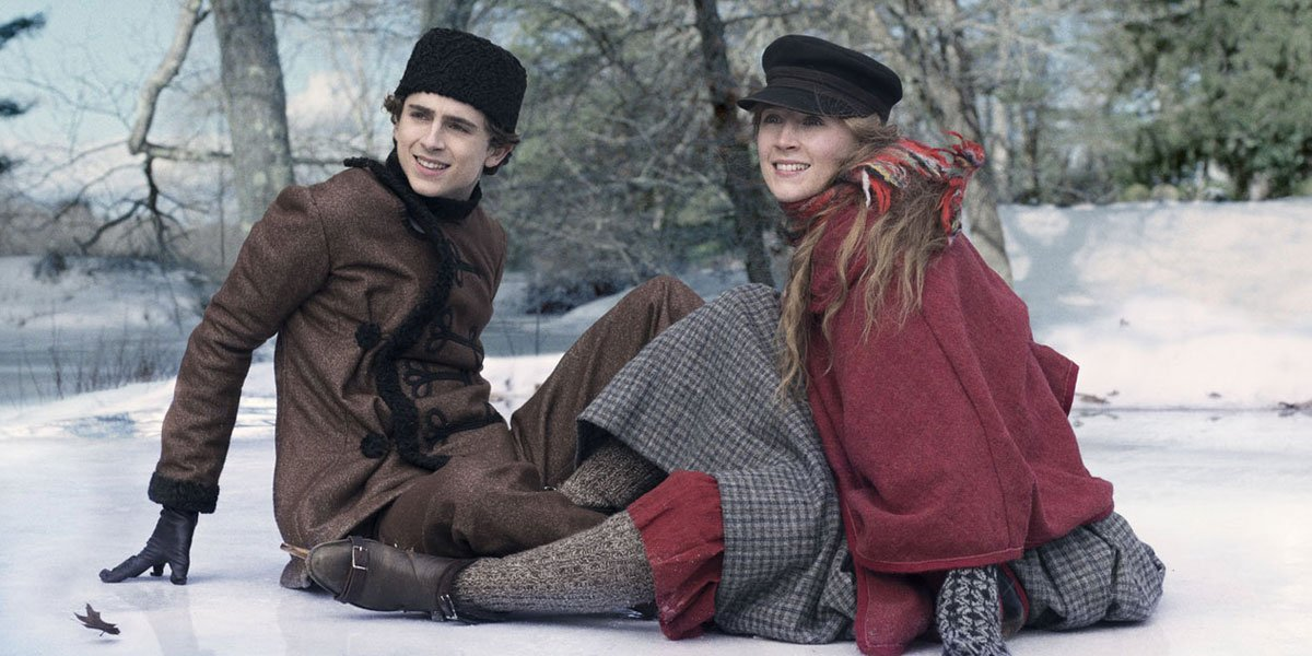 Jo and Laurie in the snow in Little Women 2019