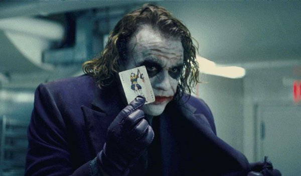 The Dark Knight Joker shows his card to the crowd