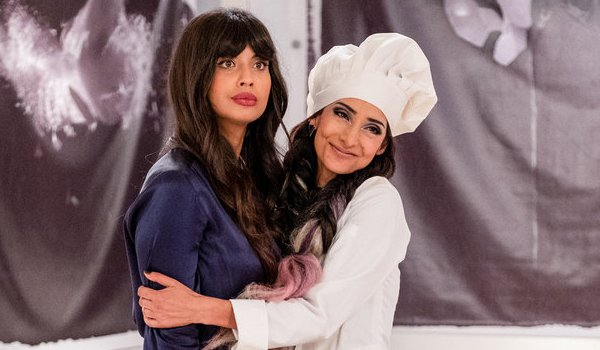 Tahani al-Jamil being hugged by her sister Kamilah on The Good Place