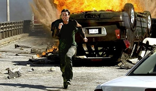 Mission: Impossible III Tom Cruise Ethan Hunt runs from an exploded car on the bridge