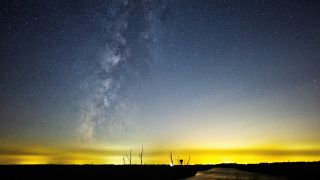 Best photo editing apps for astrophotography: Image shows milky way over stream