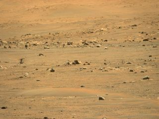 NASA's Ingenuity Mars Helicopter's was captured after landing on May 7, 2021, by the Mastcam-Z imager on the Perseverance rover after the helicopter's fifth flight, which ended at a new airfield.