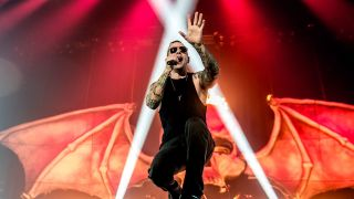 A photograph of M. Shadows of Avenged Sevenfold on stage in London