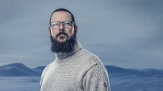 Ihsahn standing against an icy backdrop