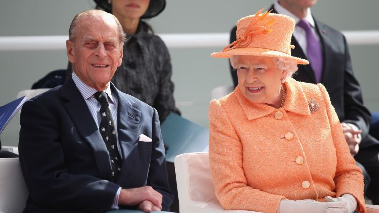 Prince Philip and Queen Elizabeth II chat as she takes part in the naming ceremony for the P&O Cruises vessel at Ocean Cruise Terminal on March 10, 2015 in Southampton, England