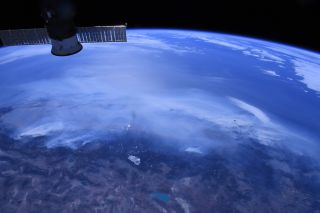 An image taken from the International Space Station shows smoke billowing across California; NASA astronaut Chris Cassidy shared the photograph on Oct. 1, 2020.