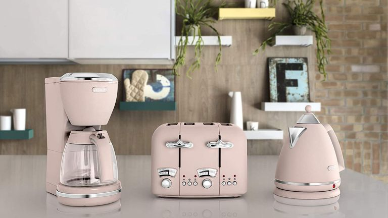 De'Longhi Argento Flora drip pink Coffee Machine on worktop beside matching kettle and toaster