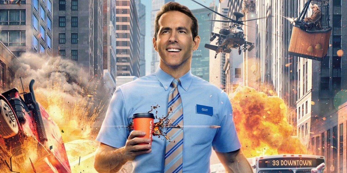Free Guy Ryan Reynolds walks with a coffee, amidst chaos