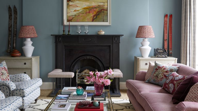 living room with blue walls and pink sofa in Edinburgh Georgian townhouse designed by Jessica Buckley