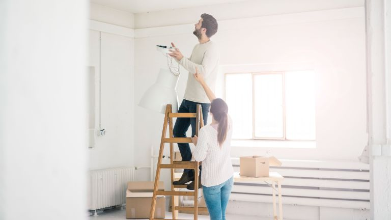 man and woman undertaking diy by getty images