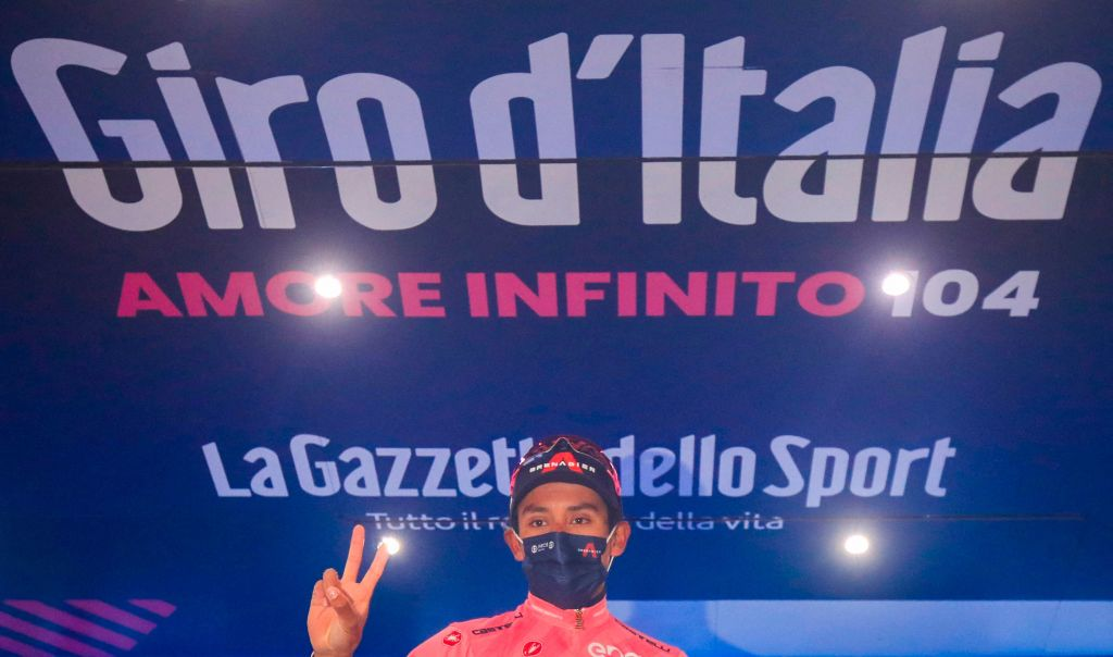 Oveall leader Team Ineos rider Colombias Egan Bernal celebrates on the podium after winning the 16th stage of the Giro dItalia 2021 cycling race 153km between Sacile and Cortina dAmpezzo on May 24 2021 Photo by Luca Bettini AFP Photo by LUCA BETTINIAFP via Getty Images