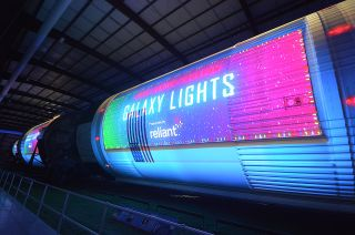 Space Center Houston's new Galaxy Lights, presented by Reliant, features projections that bring NASA's Saturn V rocket to life, as a part of the most advanced light display in Texas.