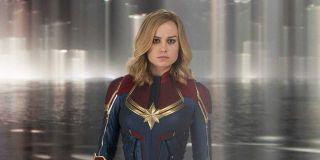 Carol Danvers (Brie Larson) stans wearing her Captain Marvel costume.