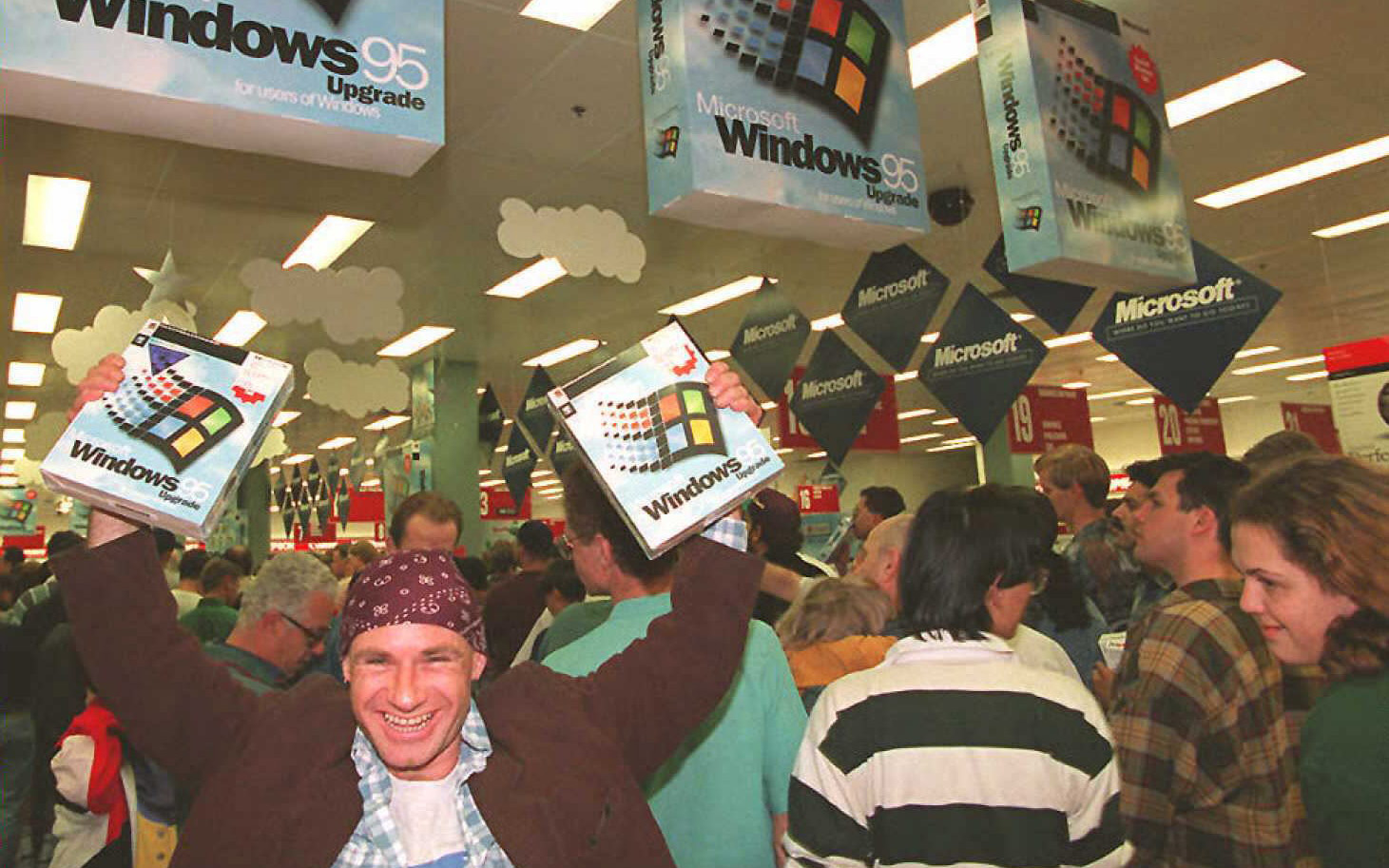Windows 95 customer Mikol Furneaux waves two boxes in the air