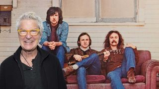 Kevin Cronin standing in front of detail from Crosby, Stills & Nash album cover