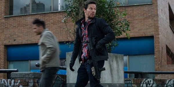 Mile 22 Mark Wahlberg James Silva patrols a block with his weapon