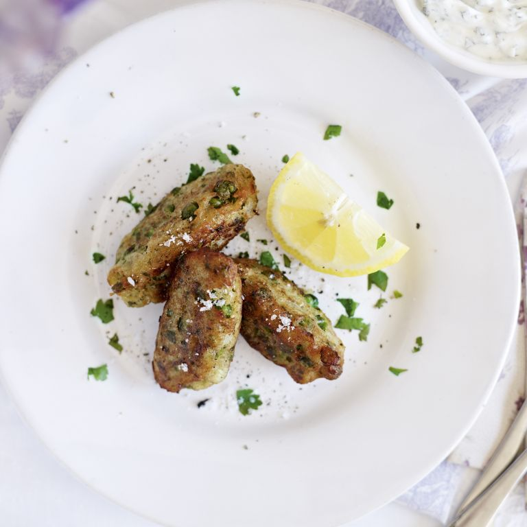 Crispy pea fritters with minty yoghurt-woman and home
