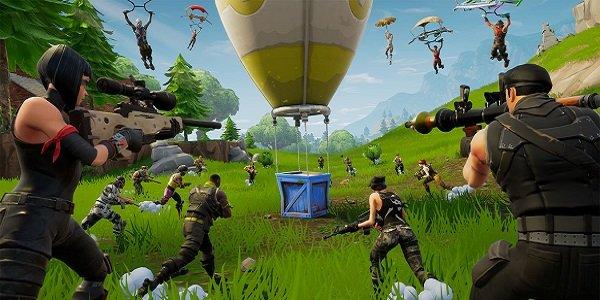 Players rush a loot drop in Fortnite.