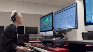 A student working in Bowes Lab at San Francisco Conservatory of Music, featuring Focusrite RedNet X2P 2x2 Dante audio interface