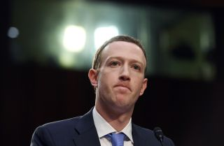 Facebook CEO Mark Zuckerberg frowns during a hearing at the Hart Senate Office Building on Tuesday, April 10, 2018, in Washington, D.C.