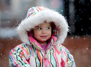 Mila Makovec, 2, came out to experience the snow with her parents on the Pearl Street Mall.