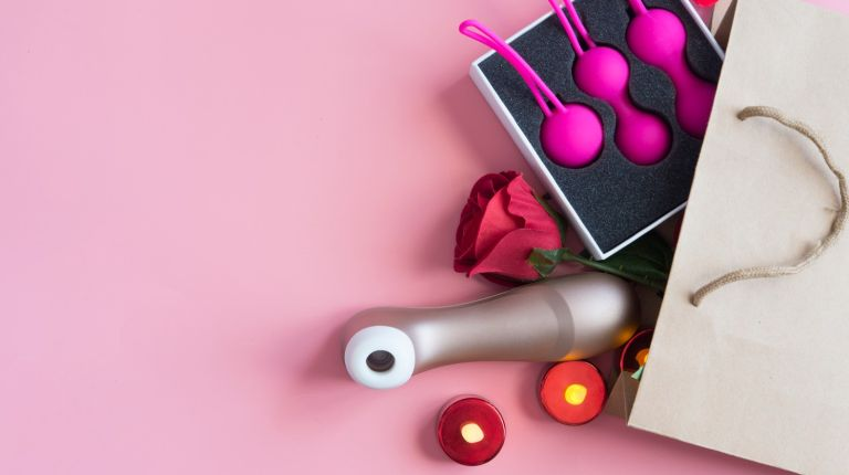 Close-Up Of Dildos On Table - stock photo