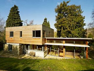 A contemporary cedar-clad home built on a conservation site in the historic city of Bath