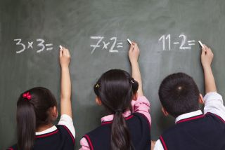 kids doing math at a chalkboard