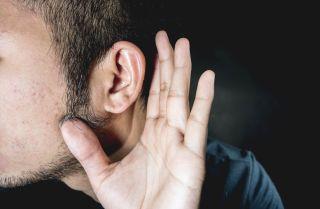Man straining to hear.