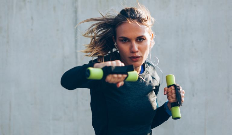 Woman doing boxercise with weights