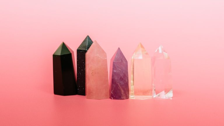 various crystals against pink background