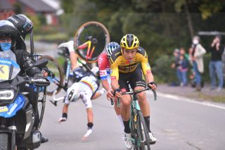 Wout van Aert (Jumbo-Visma) and Mathieu van der Poel (Alpecin-Fenix) push onwards at the 2020 Tour of Flanders as Julian Alaphilippe (Elegant-QuickStep) crashes after clipping a motorbike, ending the Frenchman's race