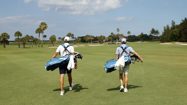 Best golf bag: Dustin Johnson of the American Nurses Foundation team and Rory McIlroy of the American Nurses Foundation team carry their bags during the TaylorMade Driving Relief Supported By UnitedHealth Group on May 17, 2020 at Seminole Golf Club in Juno Beach, Florida
