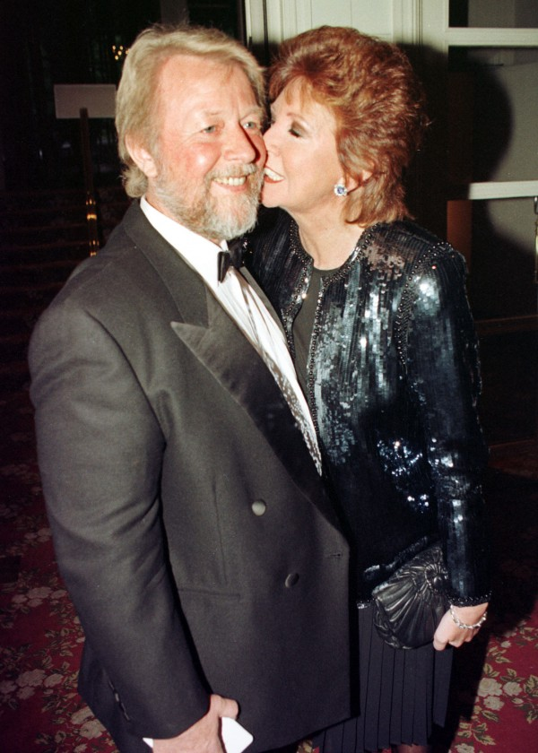 Cilla Black and her husband Bobby attending the Royal Television Society awards ceremony in 1997 (Neil Munns/PA Wire)