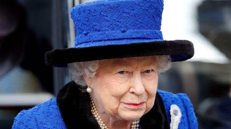 the queen in blue hat