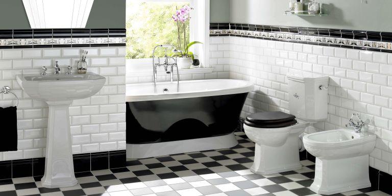 Black bathroom ideas: Art deco style black and white tiles with black bath tub by Original Style