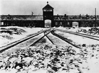 Train tracks converge at the entrance to the Nazi death camp, Auschwitz-Birkenau.