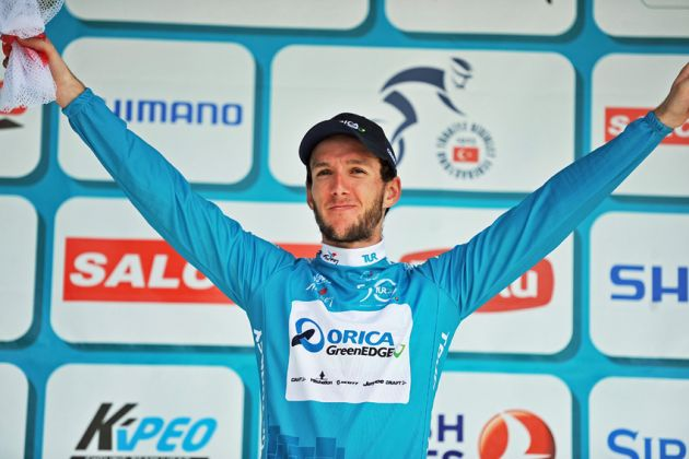 Adam Yates on the podium after retaining his overall lead on Stage 7 of the 2014 Tour of Turkey