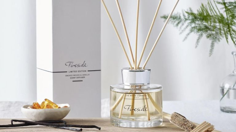 The White Company Fireside Diffuser with reeds inside, next to box