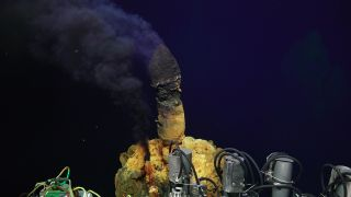 A deep-sea hydrothermal chimney pours volcanic fluid into the ocean near New Zealand.